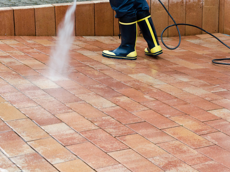 Pressure washing a driveway in southern Spain