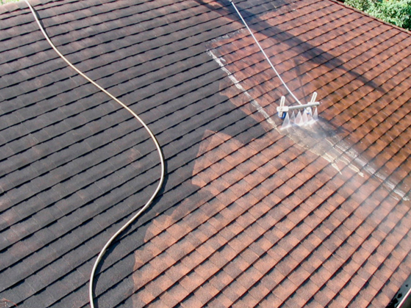 Pressure washing a Spanish tile roof
